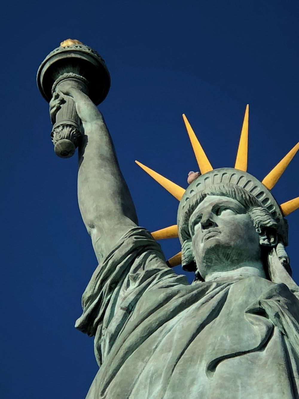 Statue of Liberty under blue sky