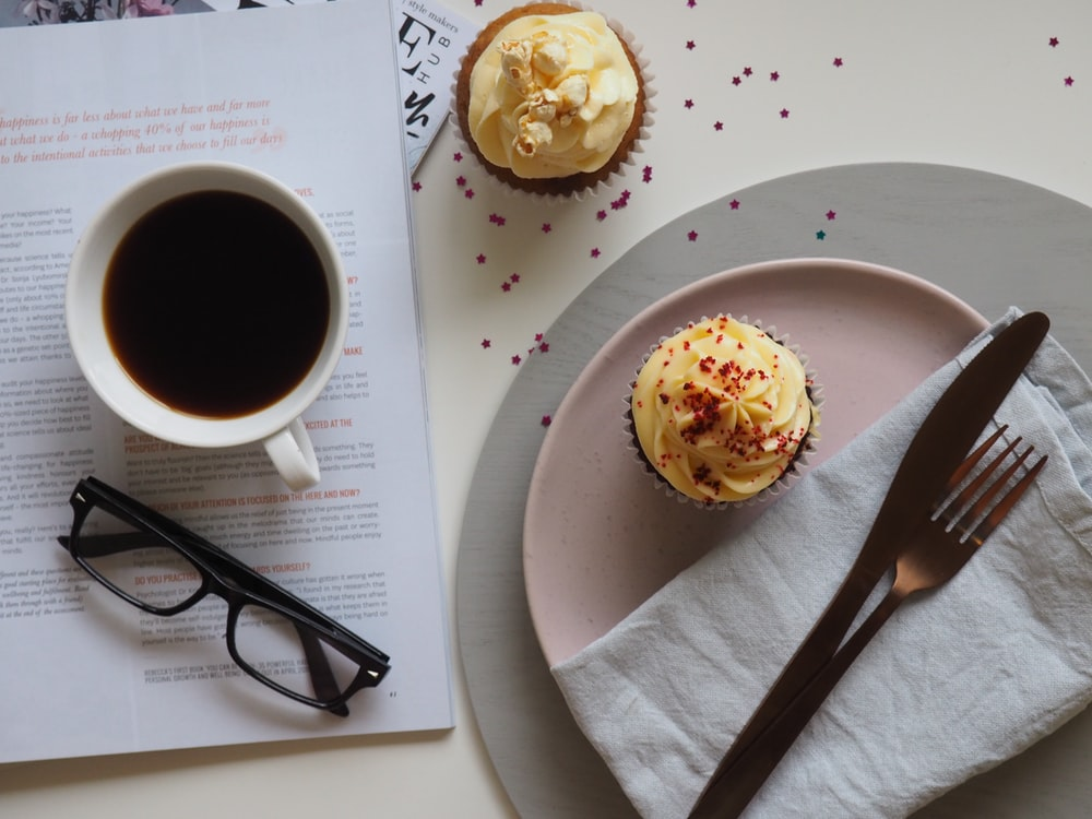 cupcake beside fork and knife