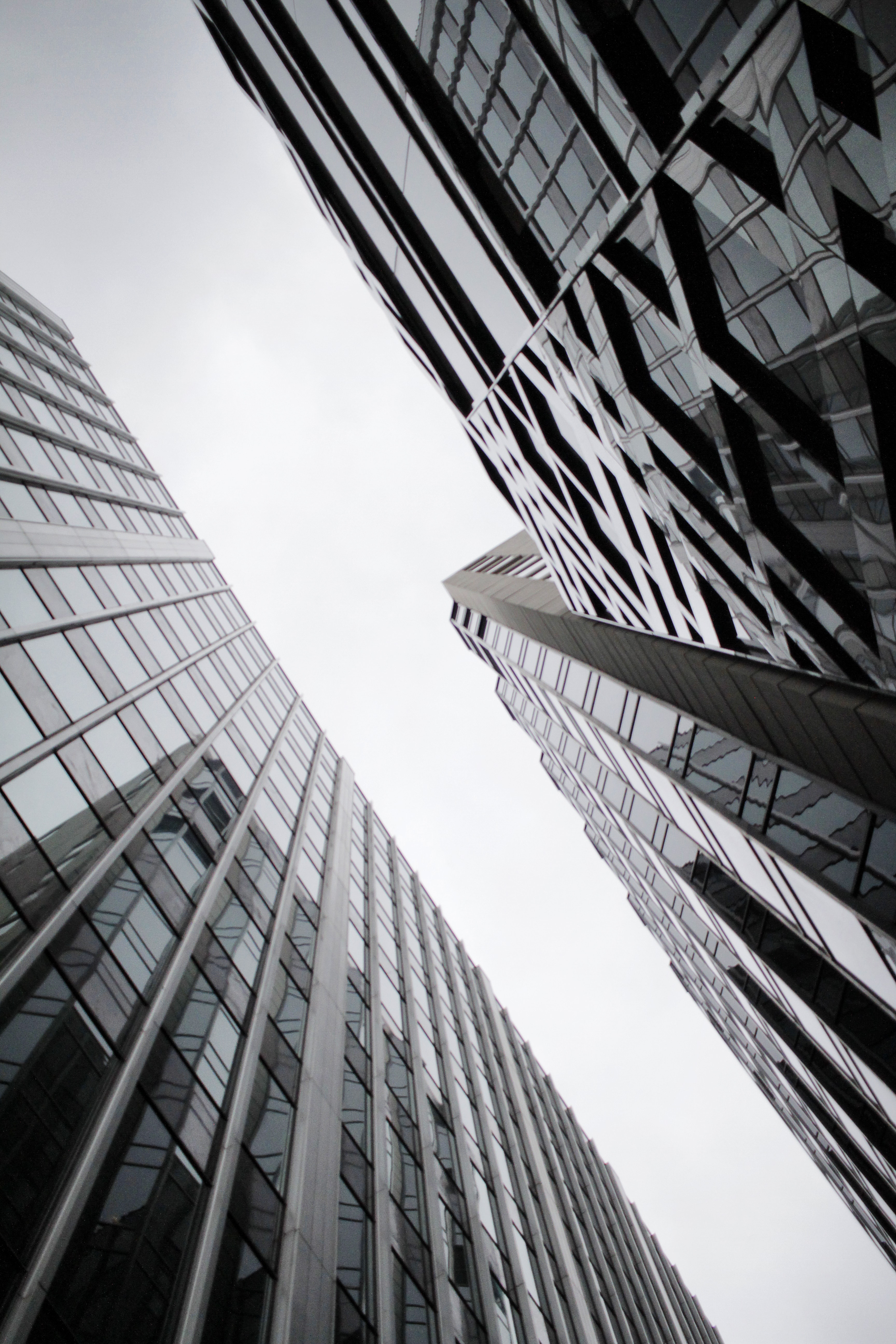 low angle photography of curtain wall glass buildings