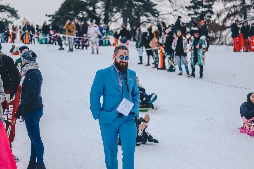 man walking on snow during daytime