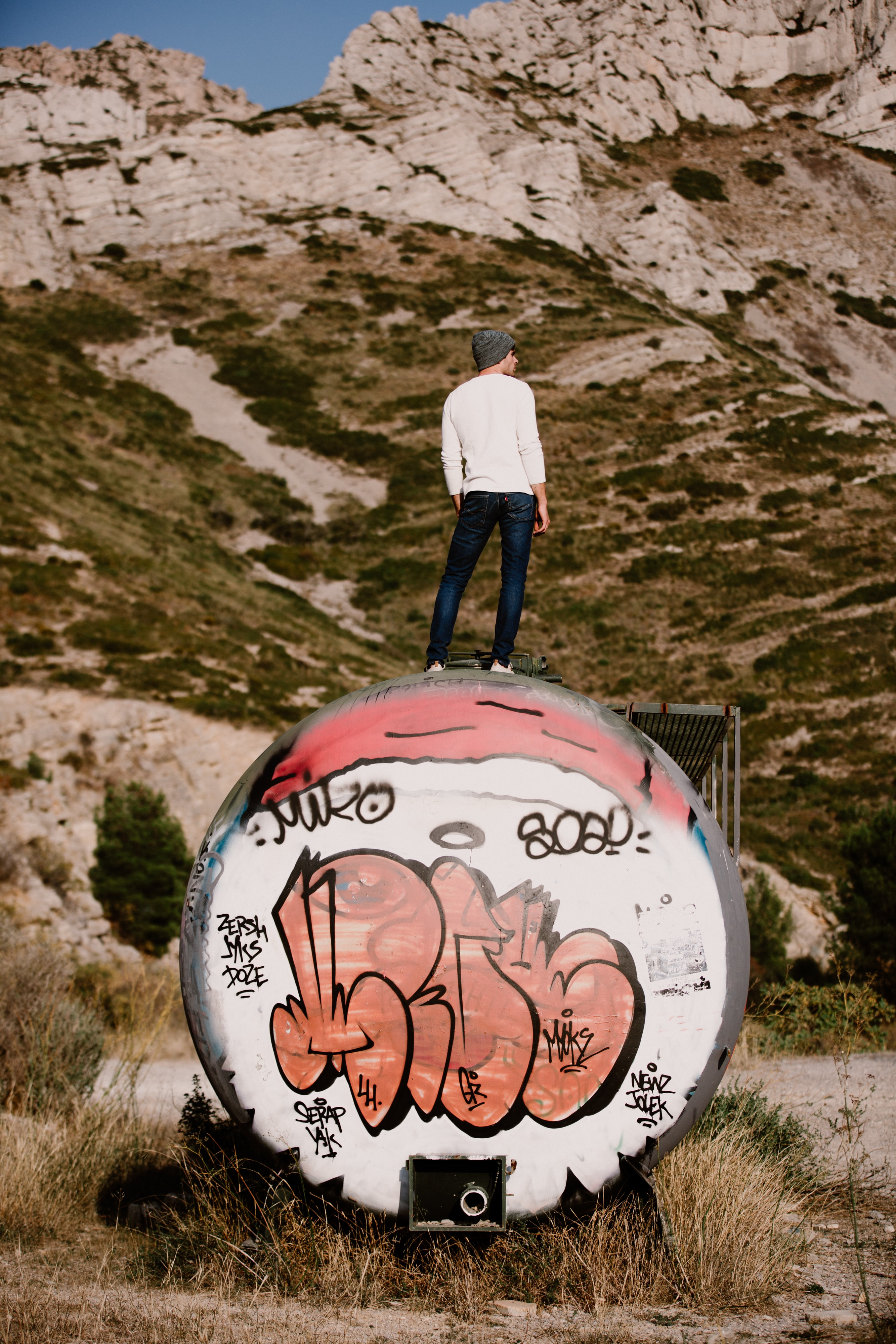 man standing near rocky mountain during daytime