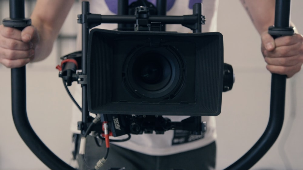 person holding camera with stabilizer