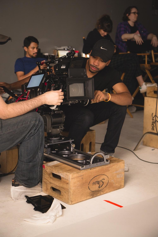 two men setting up camera inside room