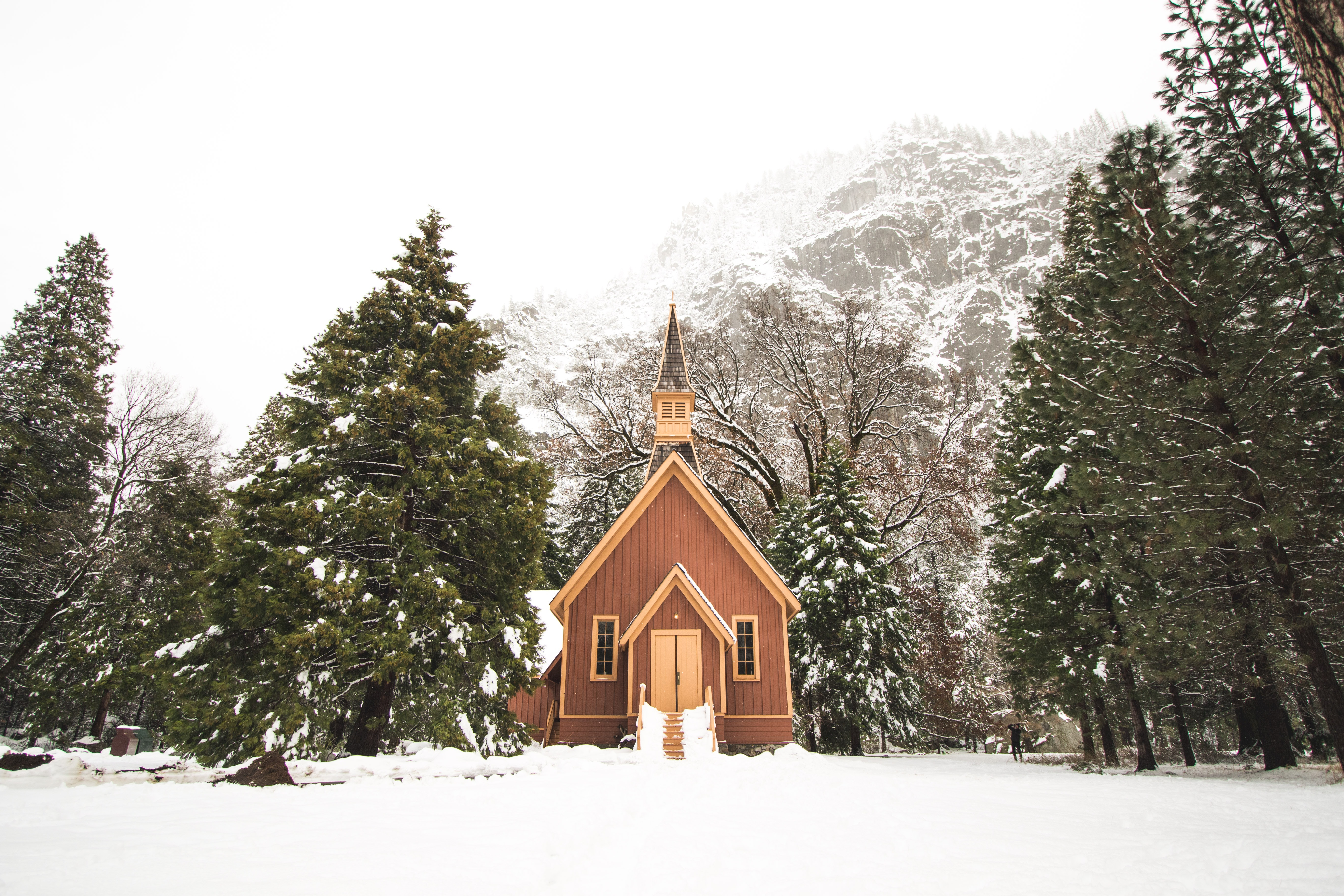 brown cathedral on snowy day