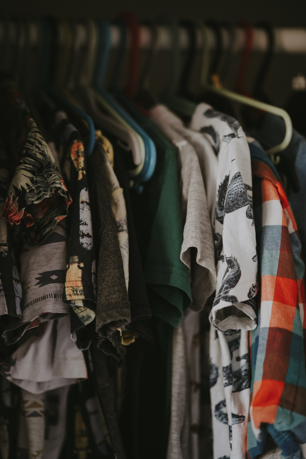 shallow focus photo of assorted clothes