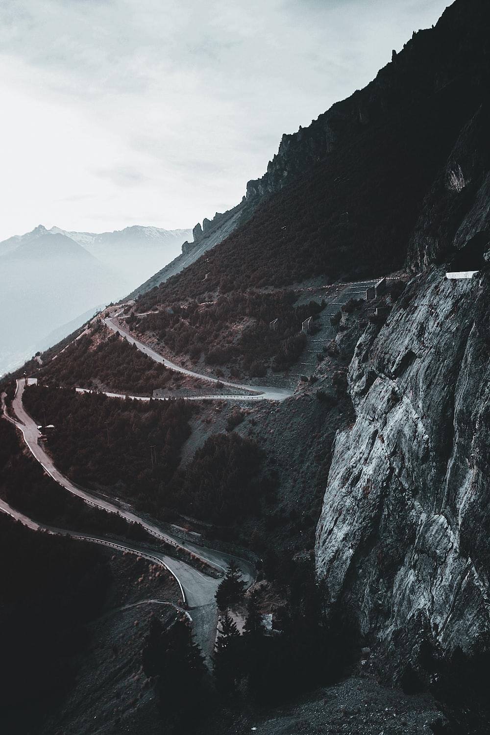 landscape photography of zig zag road on mountain