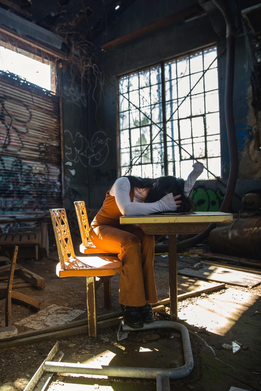 woman sleeping on table inside room