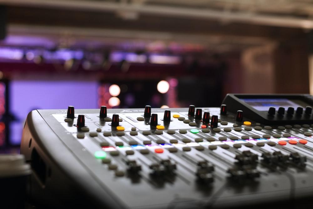closeup photography of gray audio mixer