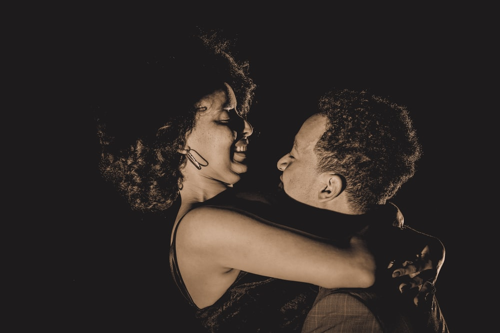 woman and woman hugging each other