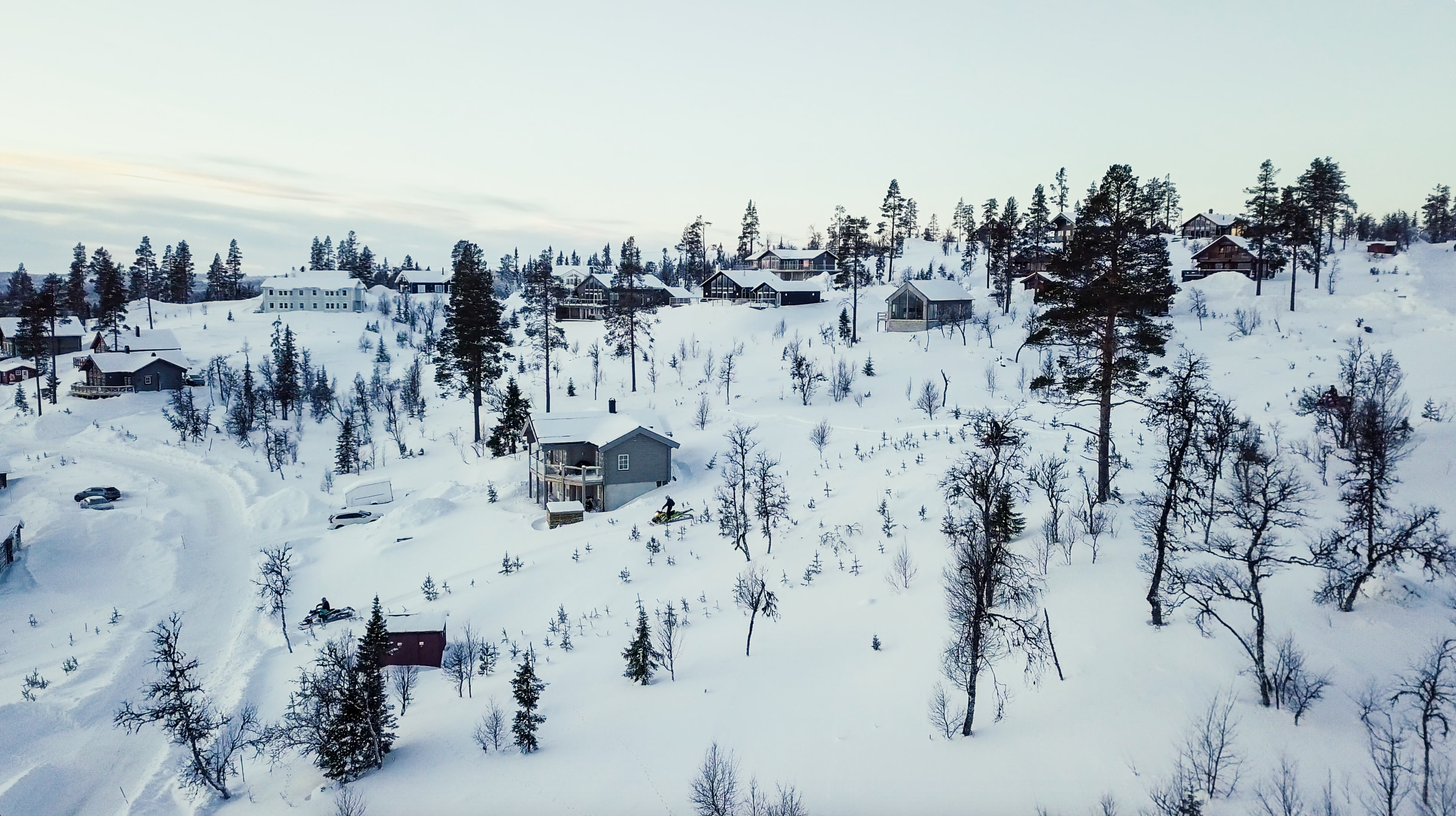 aerial shot of snow covered village