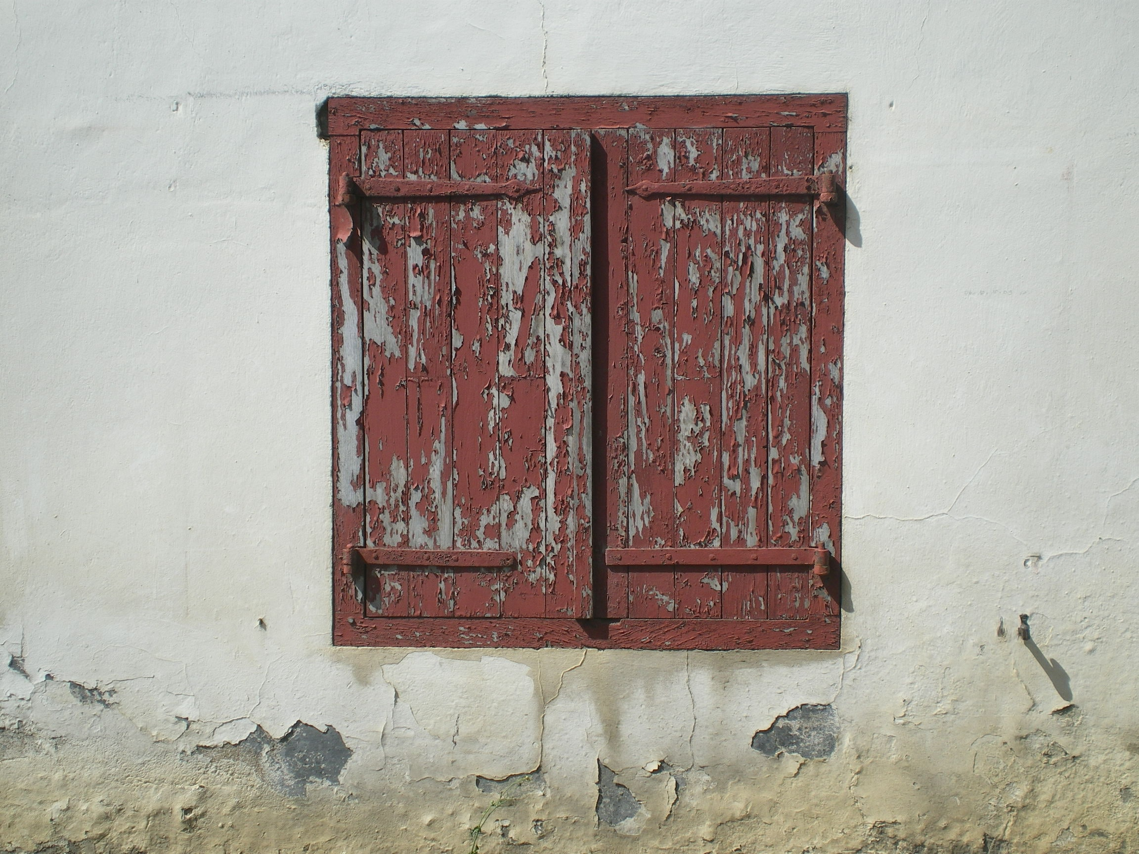 two brown wooden window in concrete