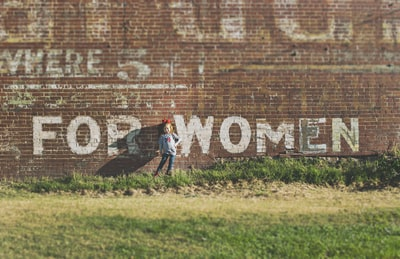 It was election day, 2016. Every single day on the way to school in this really old neighborhood of Clarksburg, we passed this faded ad painted on this brick building, and I knew that this day was going to be the day to snap a photo. That's my daughter. The day ended much different than it started, but this moment was perfect.