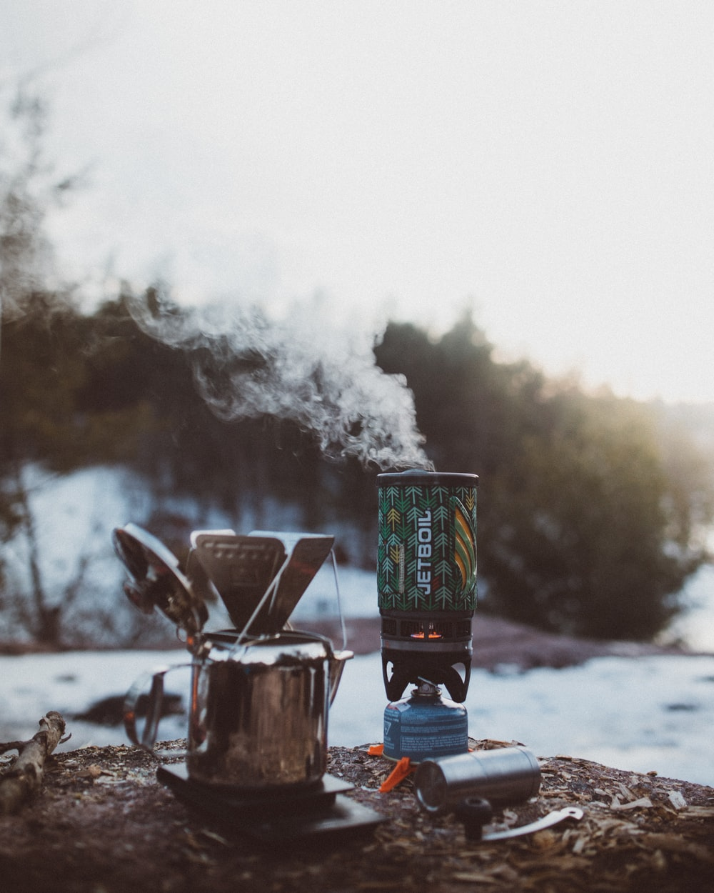 shallow focus photography of silver portable stove during daytime