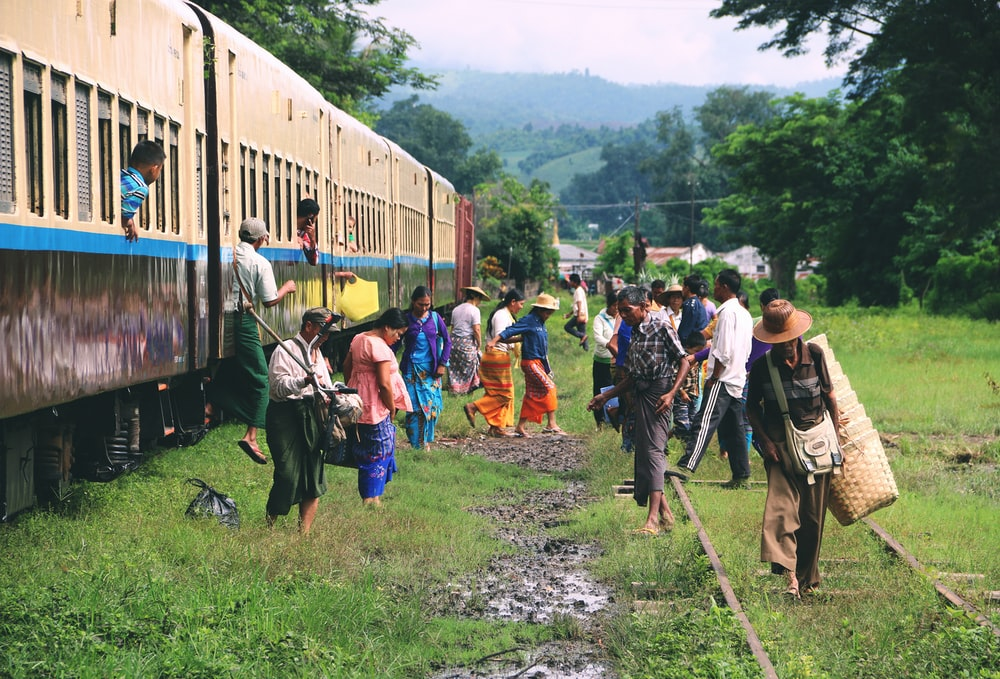 group of people standing outside train