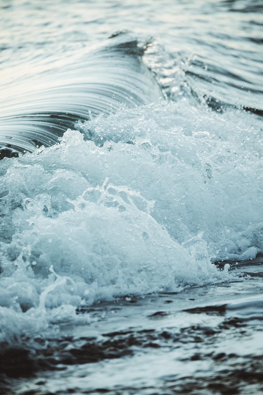 close up photography sea waves splashing on shore