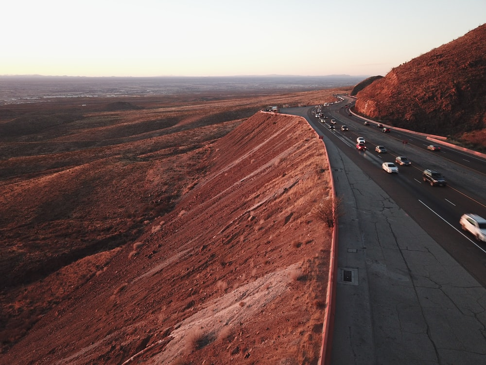 aerial photography of road and mountain