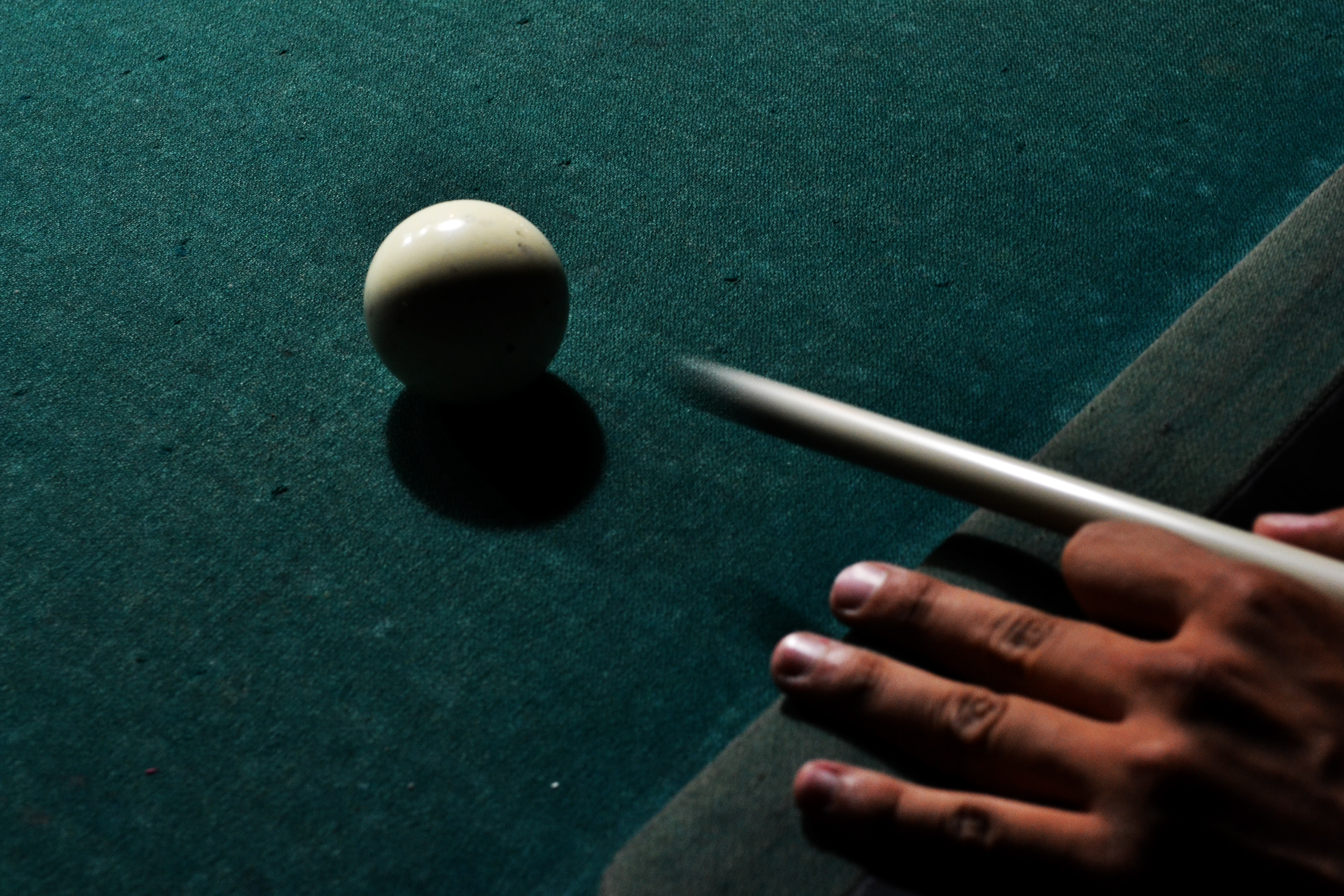 person holding brown cue stick