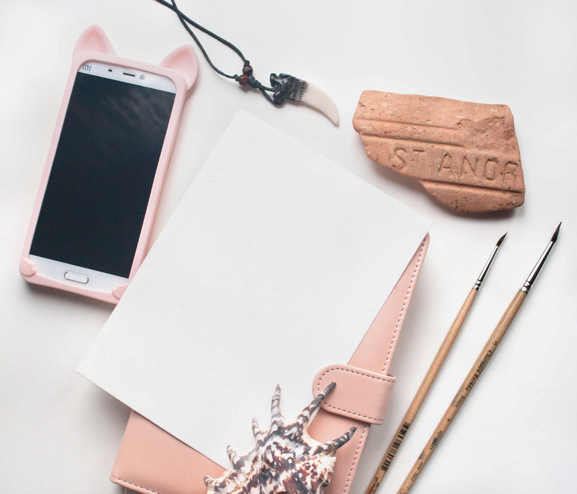 wallet and smartphone on white wooden board