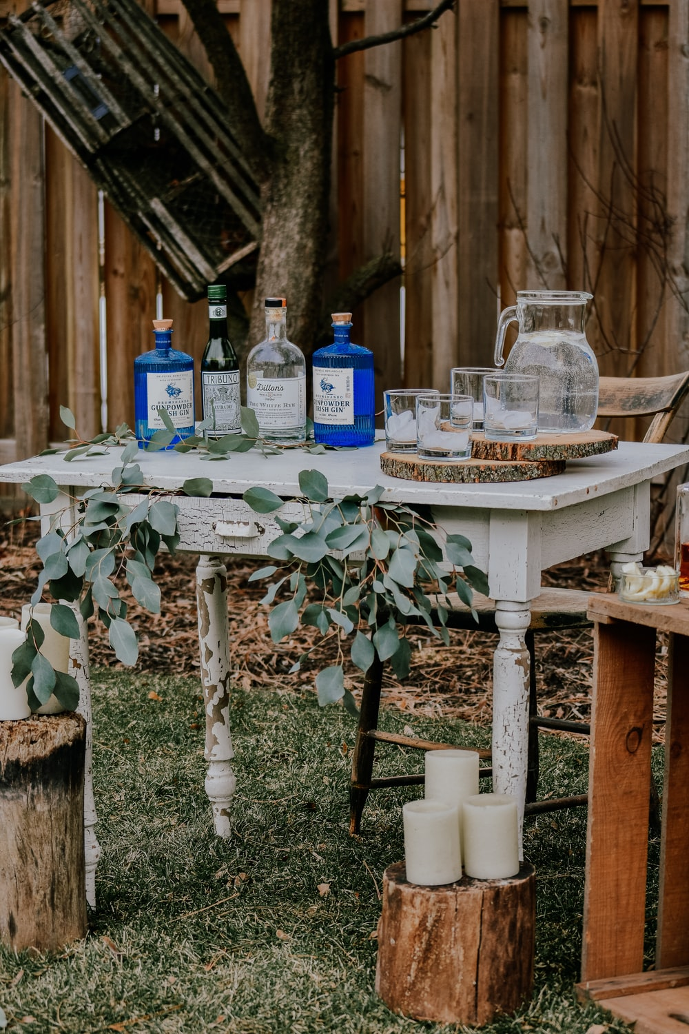 white wooden table with bottles on top