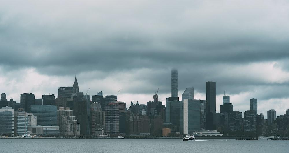 cityscape photography under nimbus clouds