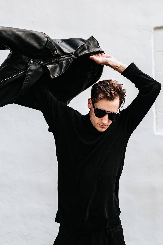 man in black long-sleeved top
