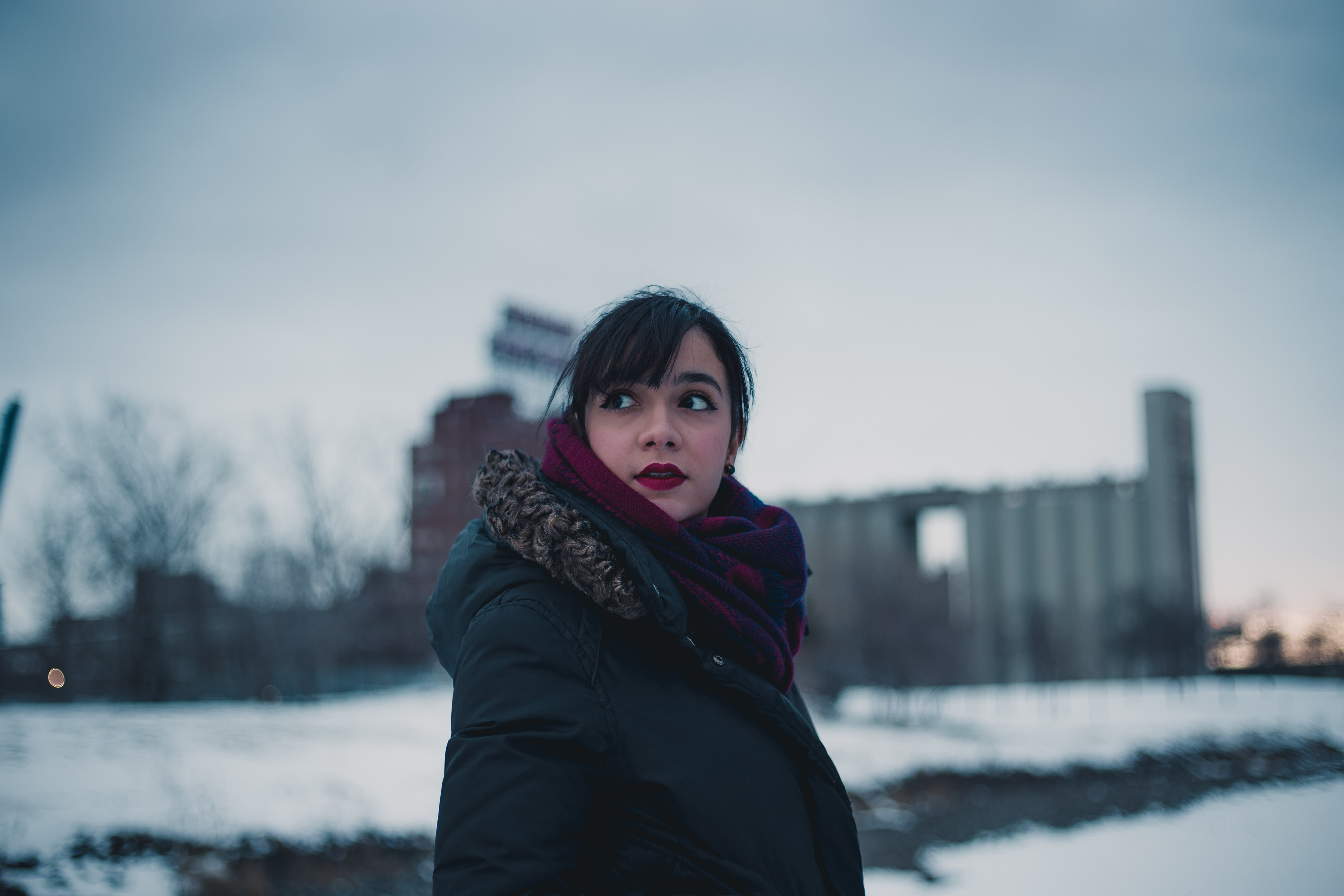 selective focus photography of woman standing on snow