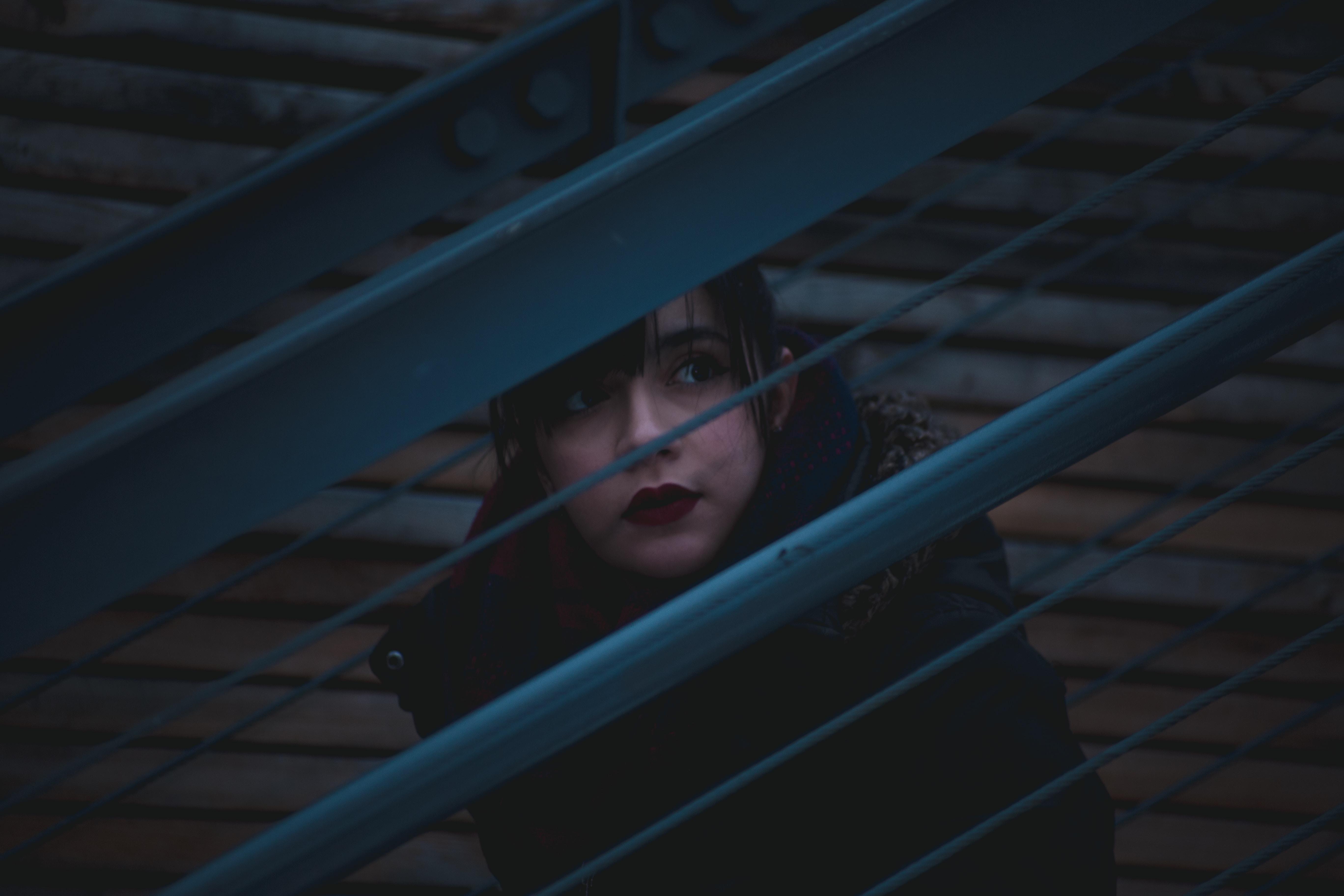 woman looking on window