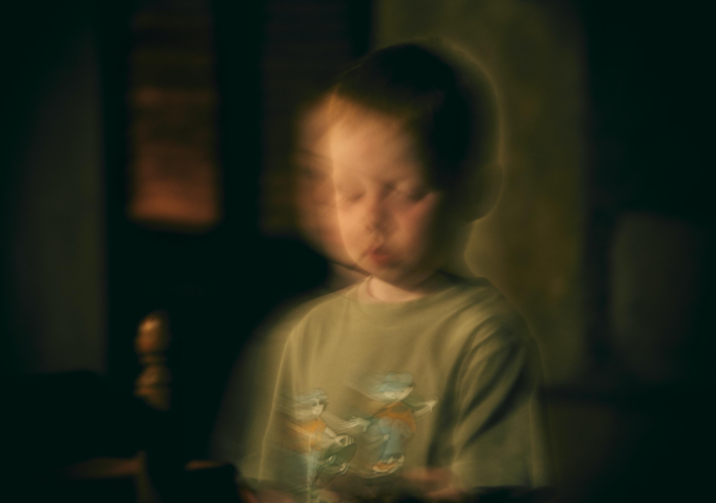 boy standing inside room