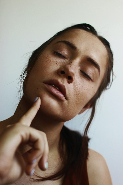 woman closing her eyes inside room