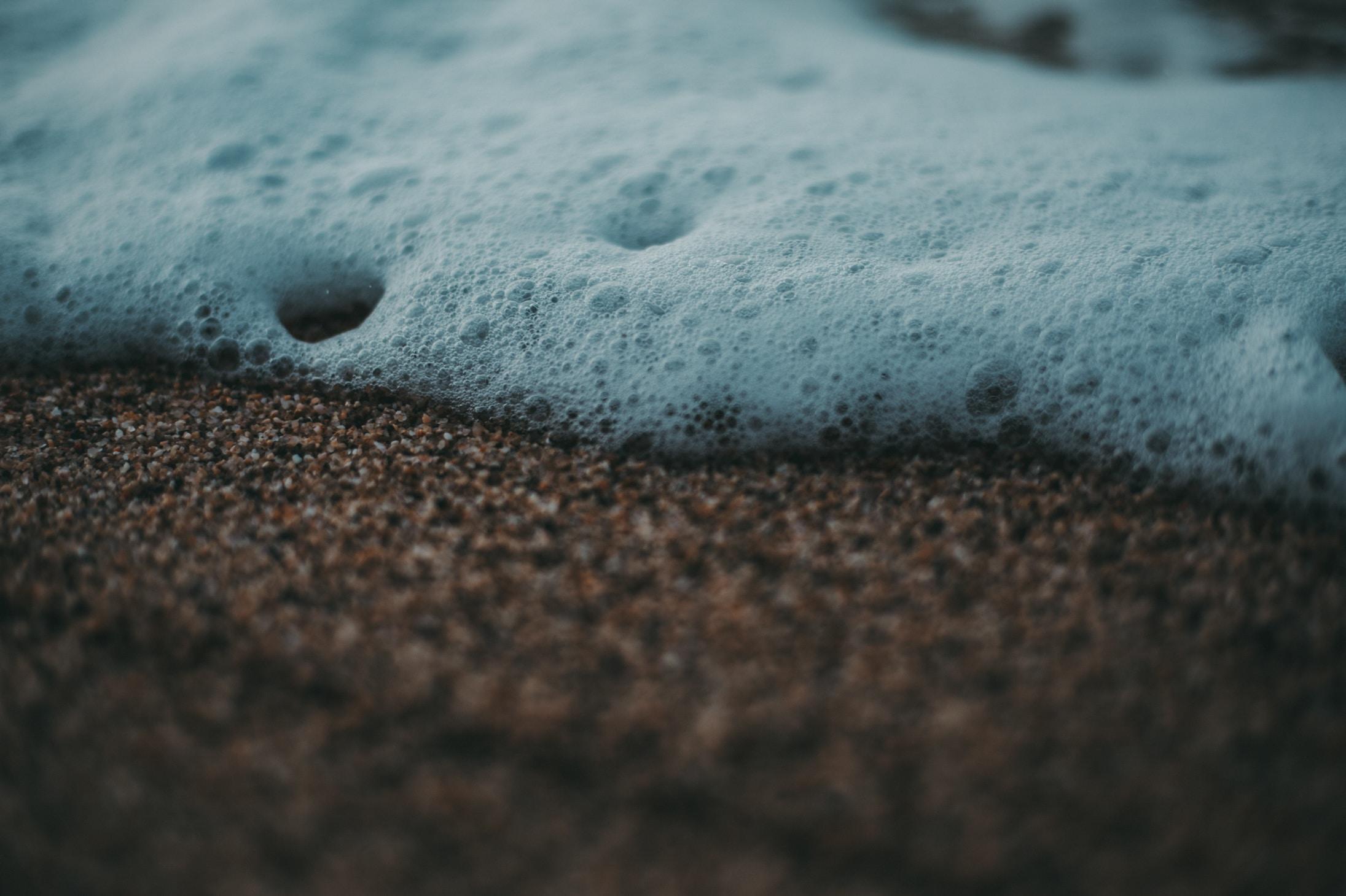 white bubbles on brown soil