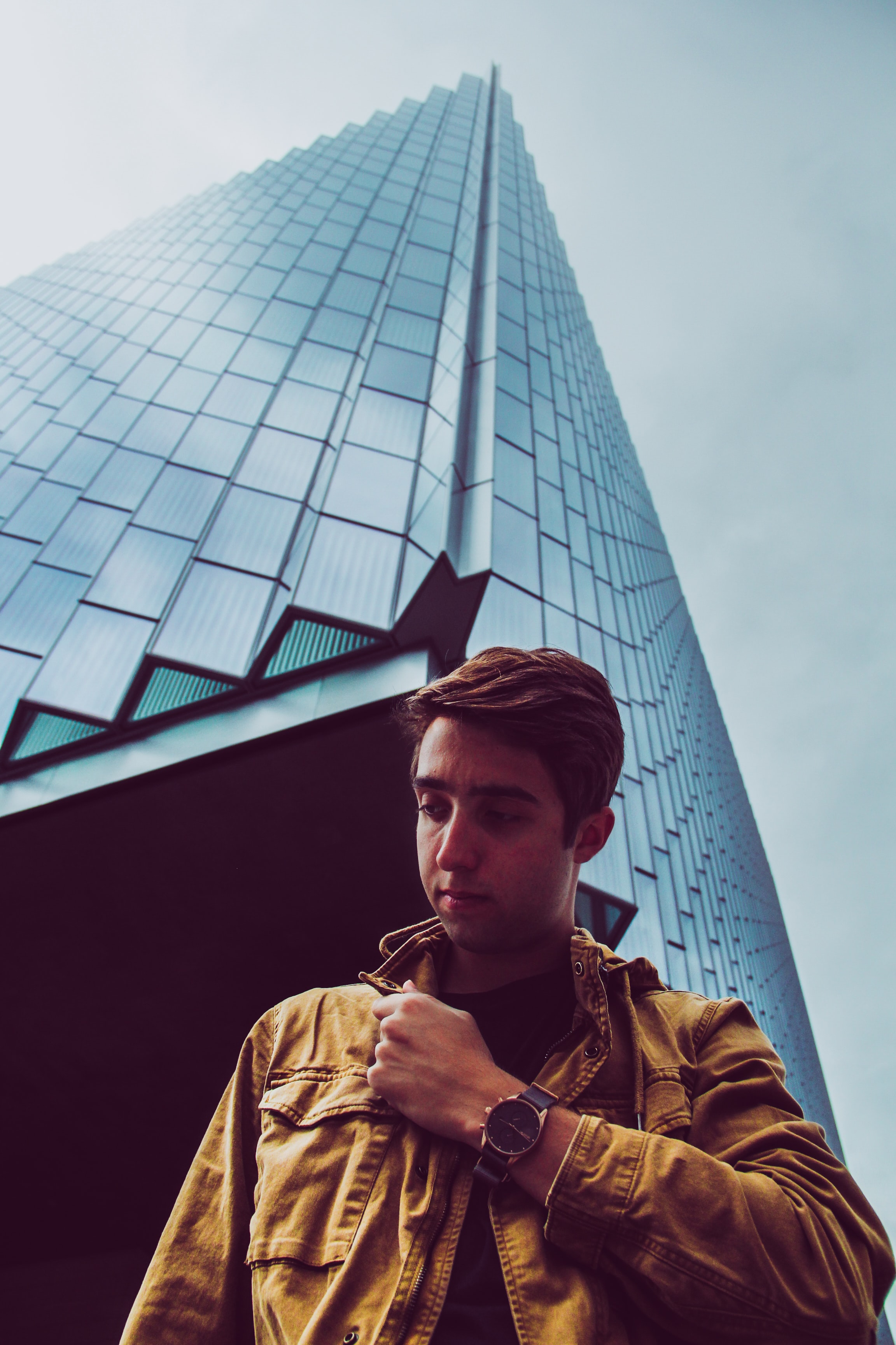 man standing beside bulding during daytime