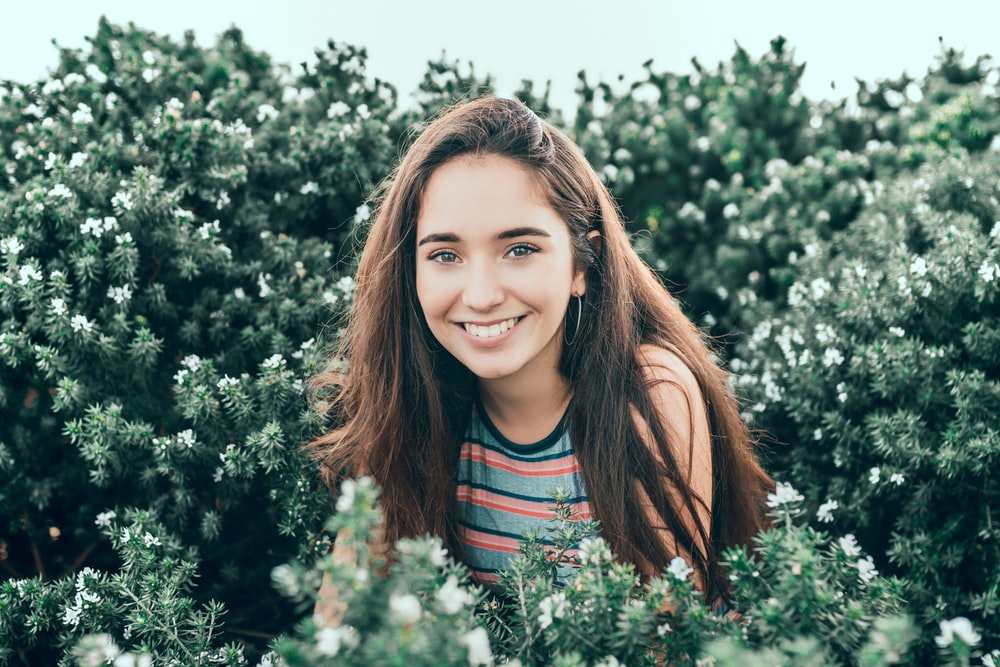 woman standing in bushes