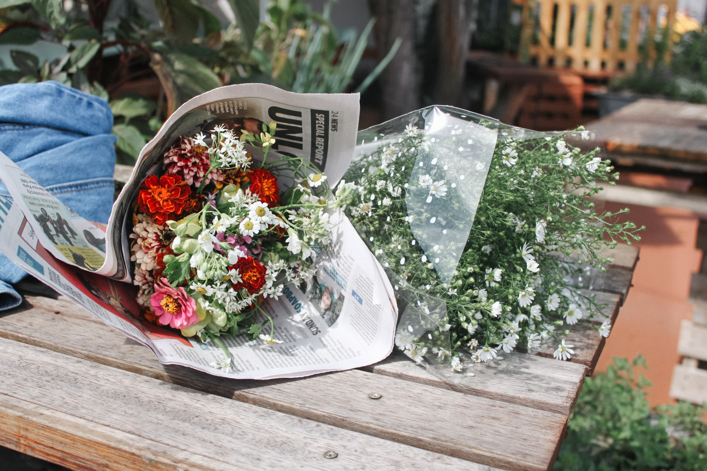 bouquet of flowers on brown wooden table