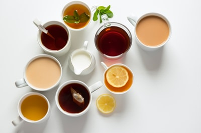 flat-lay photography of variety of beverage filled glasses tea zoom background
