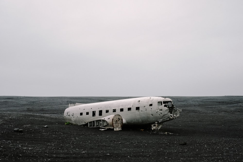 wrecked air plane on gray sand