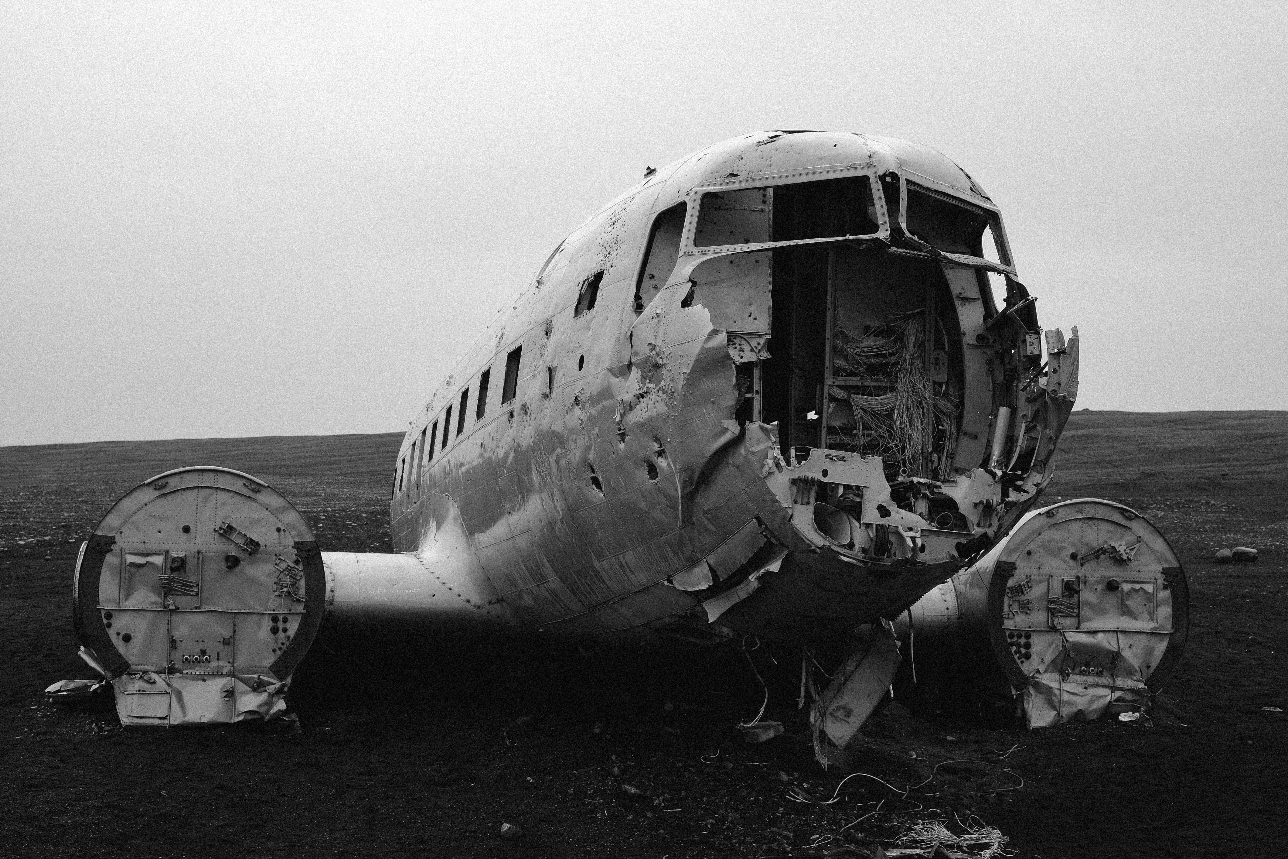 grayscale photo of crashed plane
