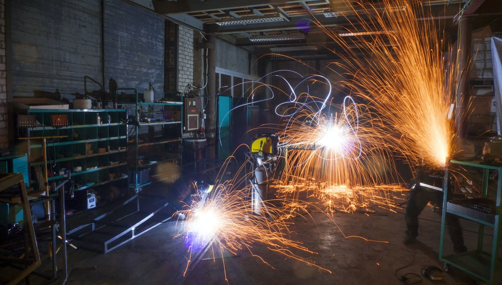 time lapse photography of person doing machine works
