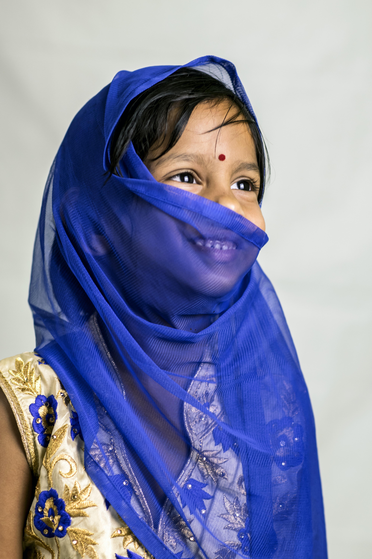girl in blue hijab veil smiling