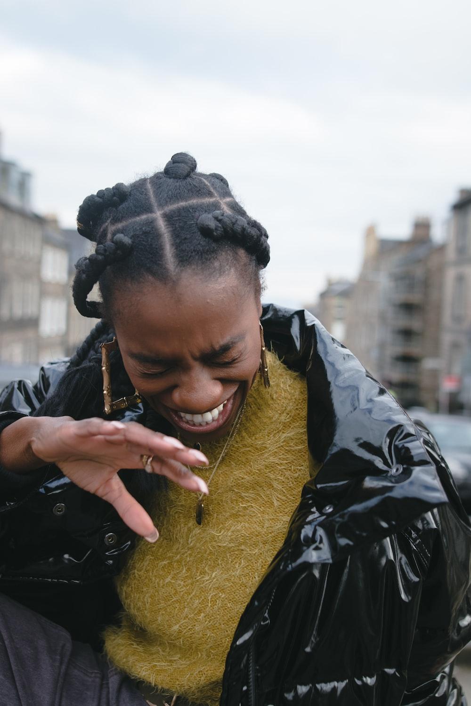 woman in black jacket on street