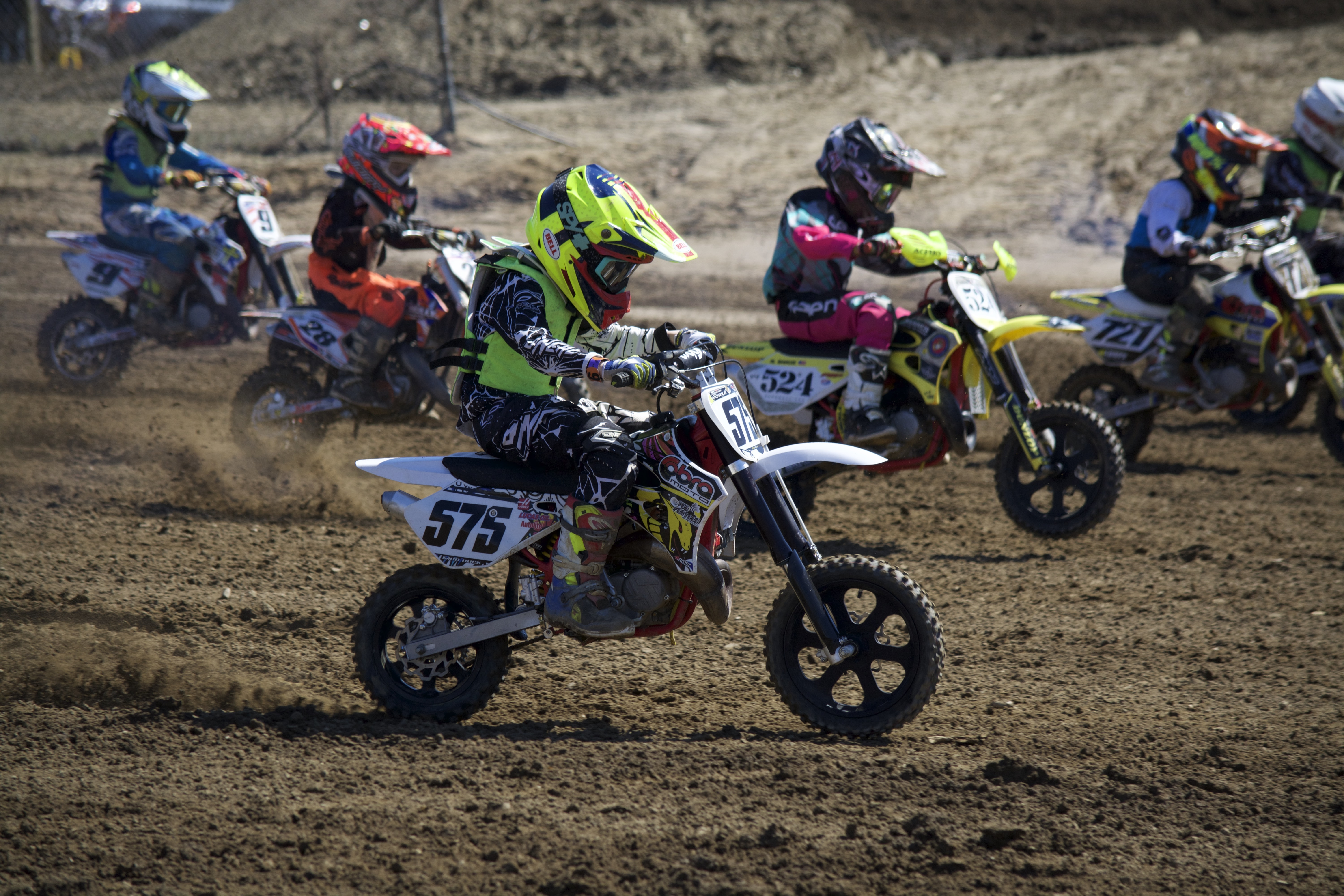 toddler dirt bikers on track