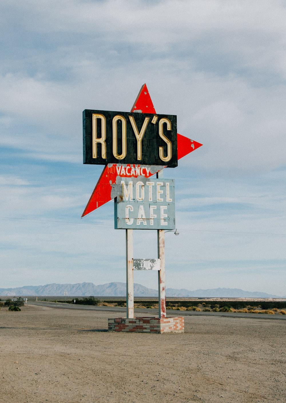 black and gray Royś motel cafe signage