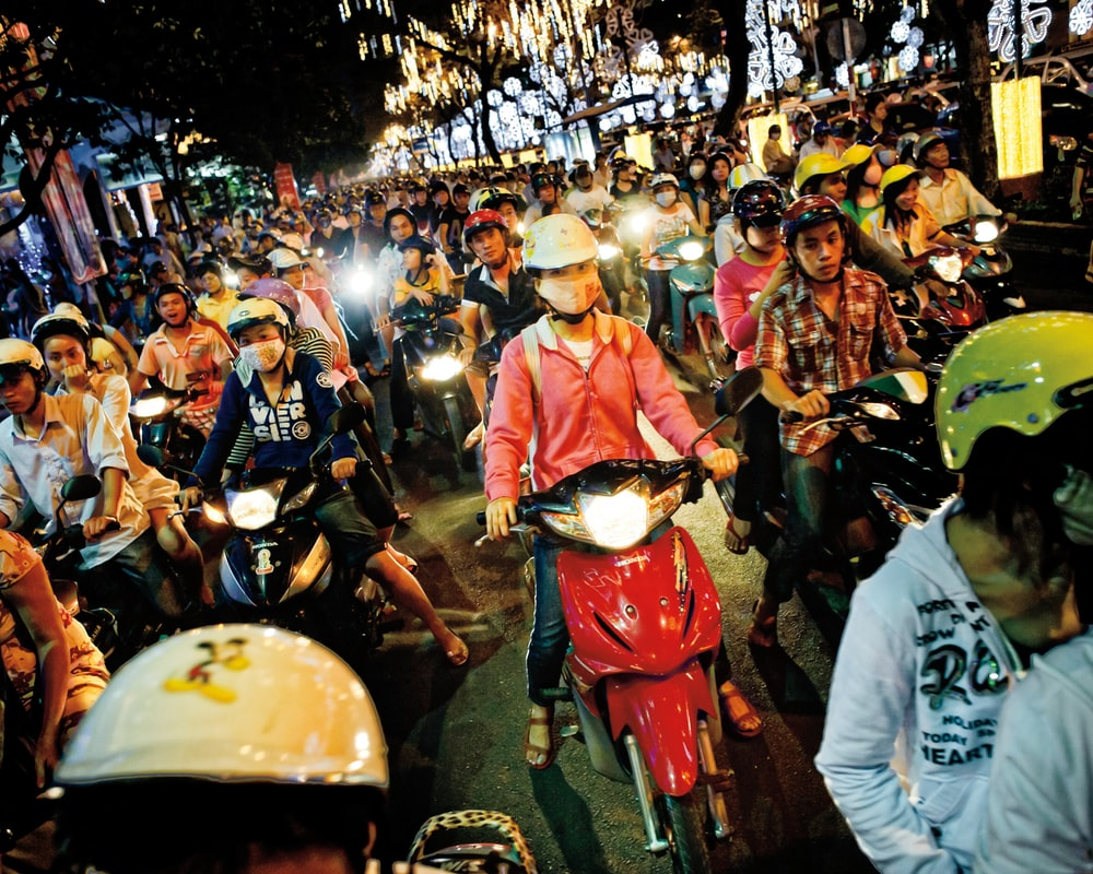 group of people riding a motorcycle