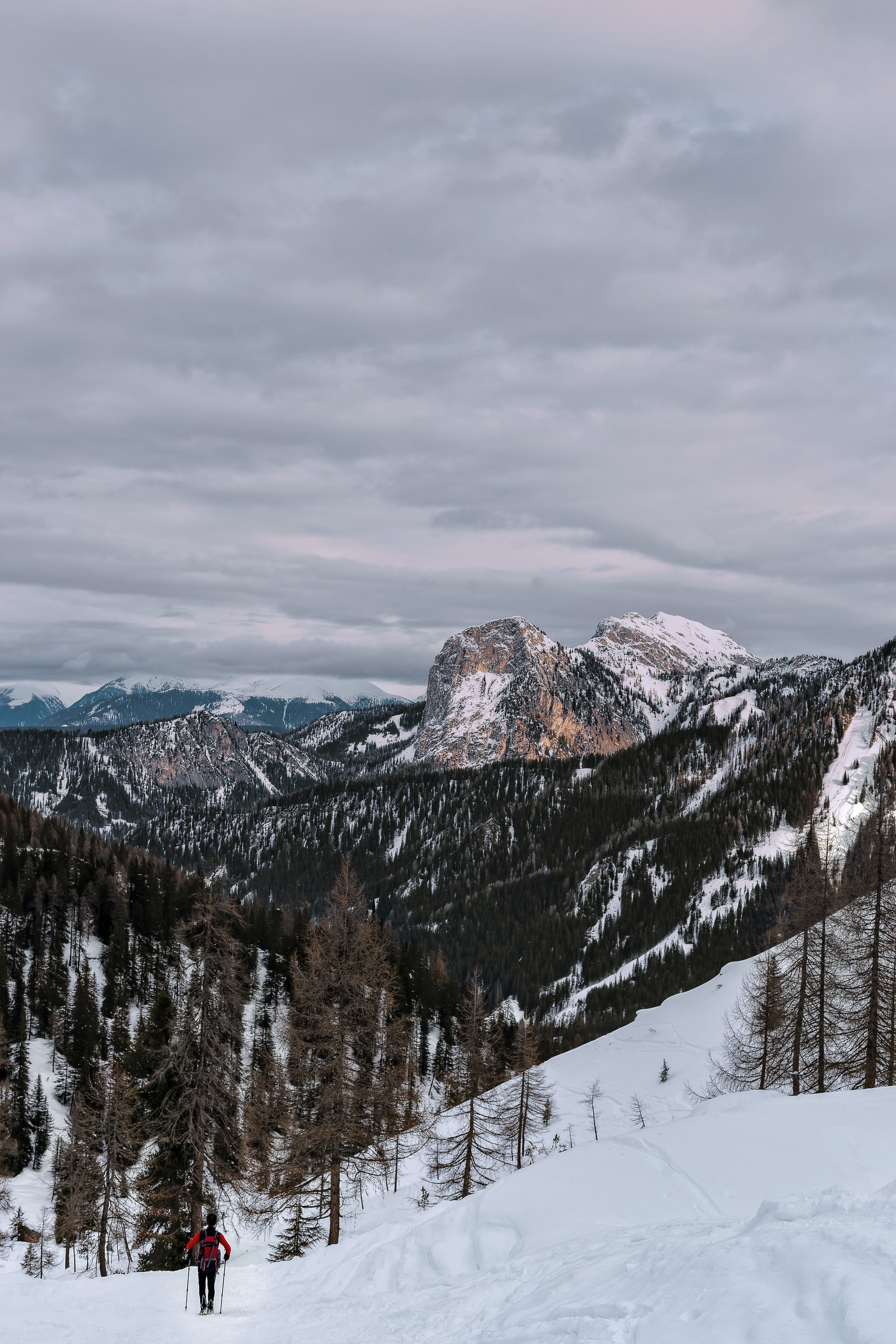 mountains covered with snow during cloudy daytime