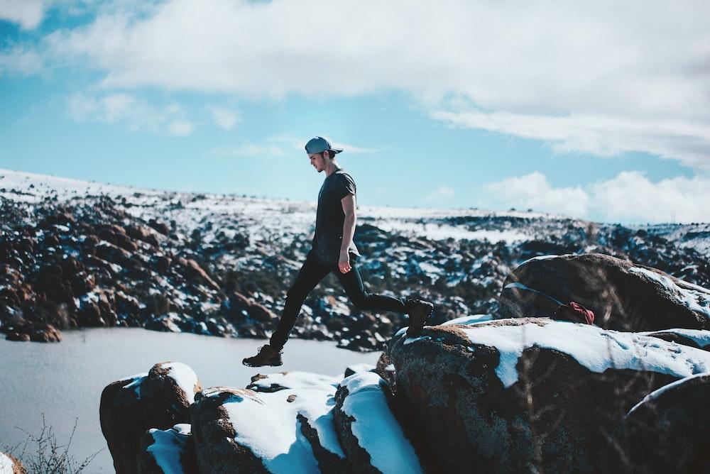 man walking on the rocks