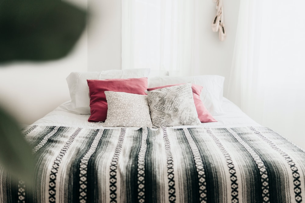 bed with throw pillows and blanket