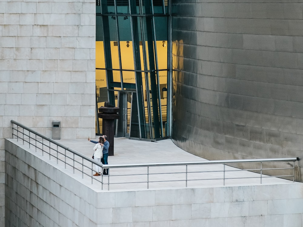 couple taking picture together on top of building