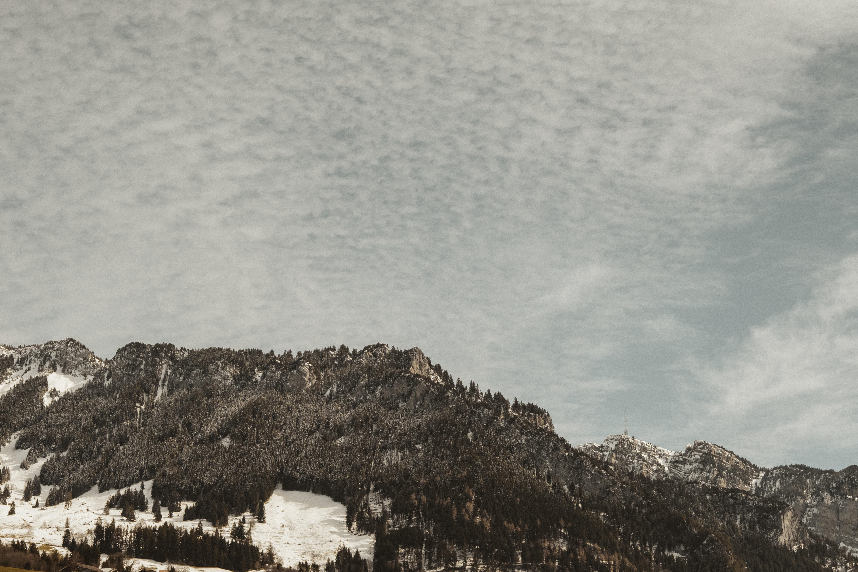 mountain under gray sky