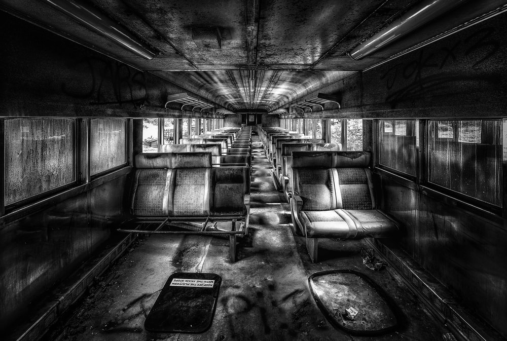 grayscale digital painting of train interior