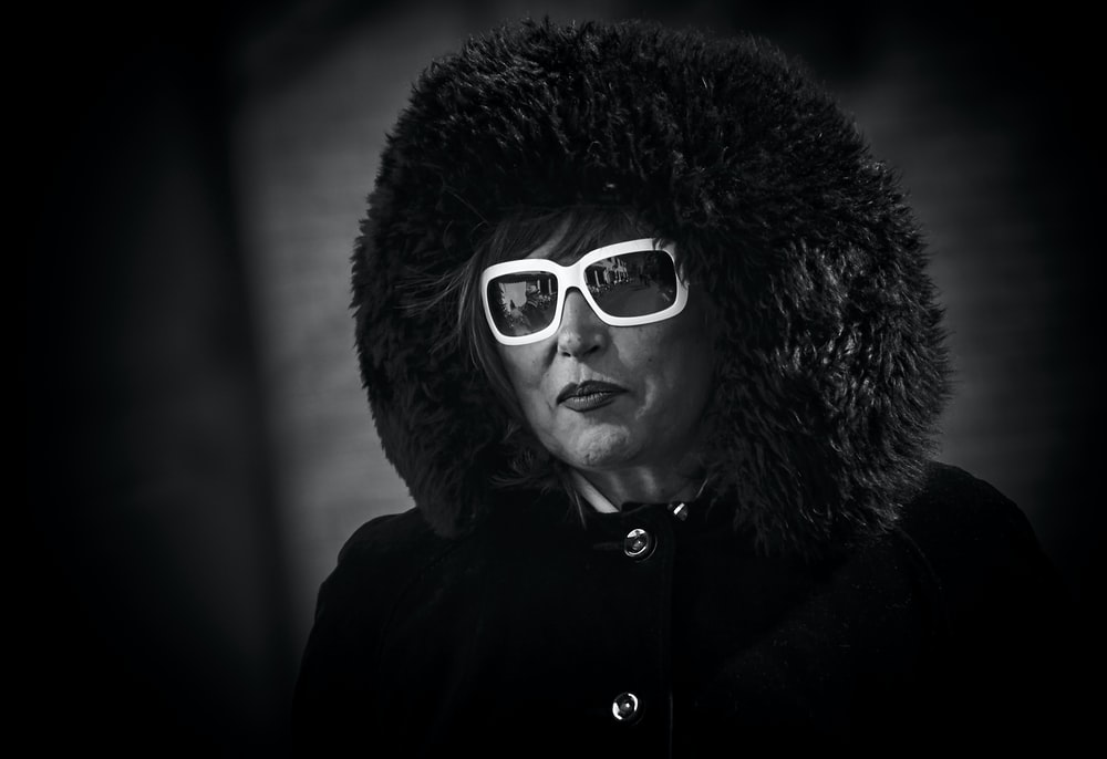 selective color of woman wearing white framed sunglasses
