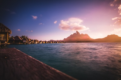 huts neat water and mountain bora bora teams background